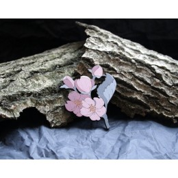 Brooch in the form of sprig of pink flowers.
