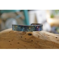 Textured handmade bracelets made of titanium.