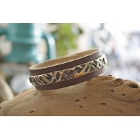 Bracelets made by hand  from leather and steel.