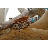 Bracelets made from leather with stainless steel inserts.