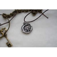 Laconic and fabulous pendant, with the image of starry sky and Crescent