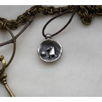 Laconic and fabulous pendant, with the image of а cartoon raven