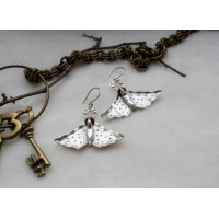 Earrings of a authors work, in the shape of moth