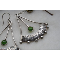 Earrings of a authors work, covered by silver
