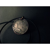 Medallion with the image of a city and a cat